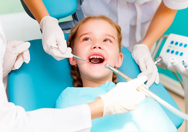 Пломбирование зубов у детей